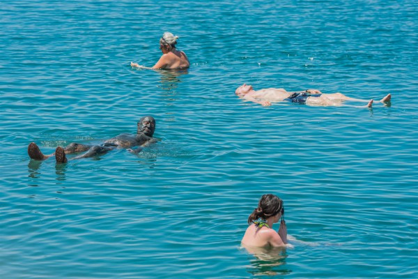 Dead Sea-tourists-swimming-floating-mud treatment