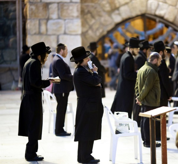Jewish men pray at the Western (Wailing) Wall in Jerusalem.