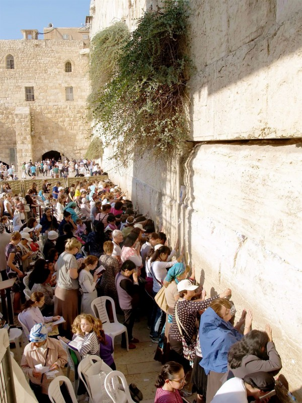 Jewish women pray at the Western (Wailing) Wall in Jerusalem. The Wall was part of the retaining structure that supported the Temple Mount. Of the four walls, the Western Wall is thought to be the closest to the spot where the Temple was located. While the Temple Mount is Judaism's holiest site, the Western Wall is Judaism's second, deriving its holiness from the Mount itself.