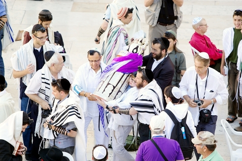 Carrying the Torah at the Western (Wailing) Wall in Jerusalem.