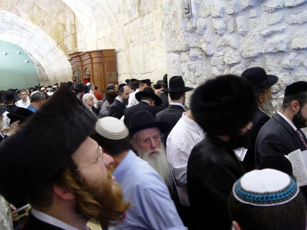 Jewish men pray at the Western Wall (photo by Israel Tourism)