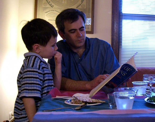Reading through the Haggadah during a Passover Seder.