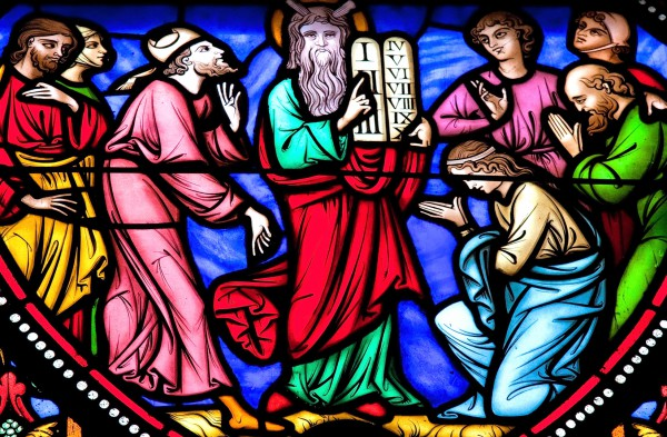 A stained-glass image of Moses and the Ten Commandments