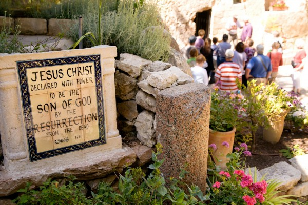 Pilgrims visit the Garden Tomb in Jerusalem.  Many believe this is the garden and sepulcher of Joseph of Arimathea, and therefore a possible site of the resurrection of Yeshua.  (Israel Tourism photo)