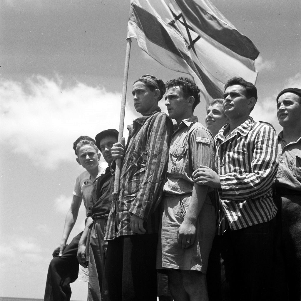 Buchenwald Concentration Camp survivors arrive in the port of Haifa in 1945. One of the first things new immigrants did when first sighting the Land of Israel was to sing HaTikvah (GPO photo by Kluger Zoltan).
