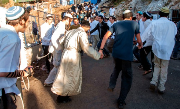 Orthodox Jewish men dance and rejoice on Lag BaOmer in Meron, the location of the tomb of Mishnaic-era sage Rabbi Shimon bar Yochai. Tens of thousands of visitors are drawn here during Lag BaOmer to pray and celebrate. Many camp out for days.