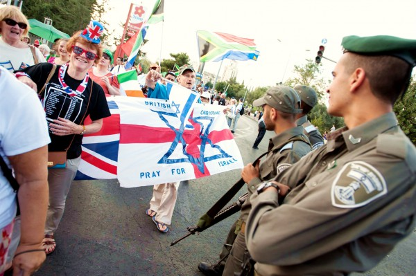 British Christian Zionists offer blessings to Israeli border police during the annual Sukkot Jerusalem March. Christian Zionists have become a potent force in international politics because of their support for the State of Israel.