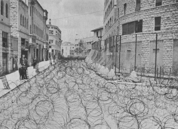 Between 1946 and 1948, the British Mandatory administration used barbed wire to secure and fortify key British installations, preventing Jewish and Arab movement. On Friday, May 14, 1948, the British Mandate ended and British forces withdrew. Israeli Irgun forces quickly took control of buildings that the British had nationalized.
