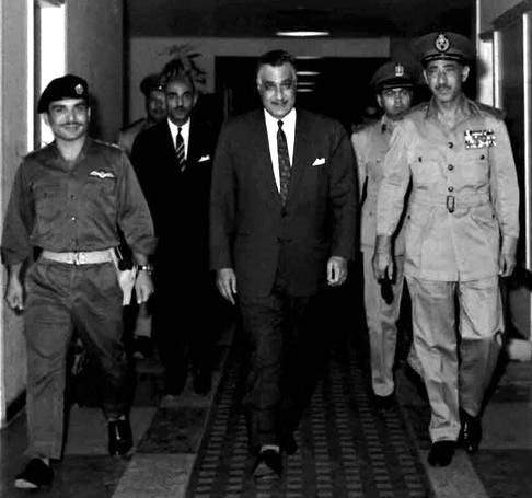Nasser (center), King Hussein of Jordan (left) and Egyptian Army Chief of Staff Abdel Hakim Amer (right) at the Supreme Command of the Armed Forces headquarters in Cairo before signing a mutual defense pact, 30 May 1967.