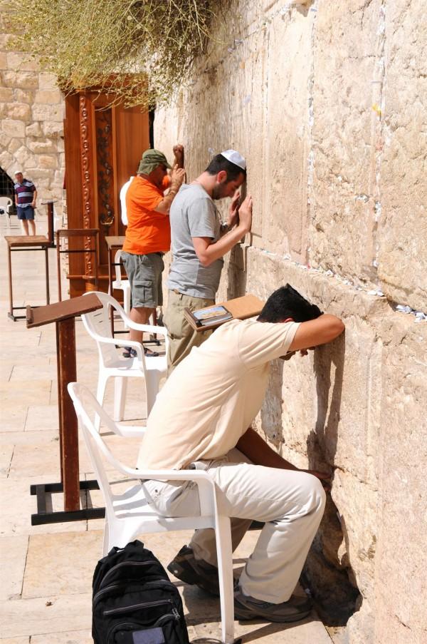 Jewish men pray at Jerusalem's Western Wall.
