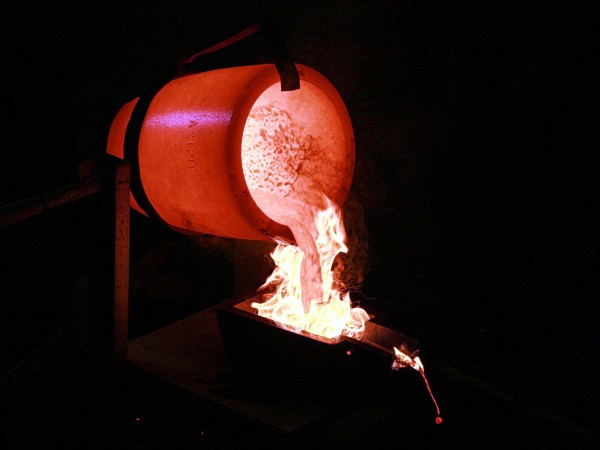 Pouring smelted gold into moulds