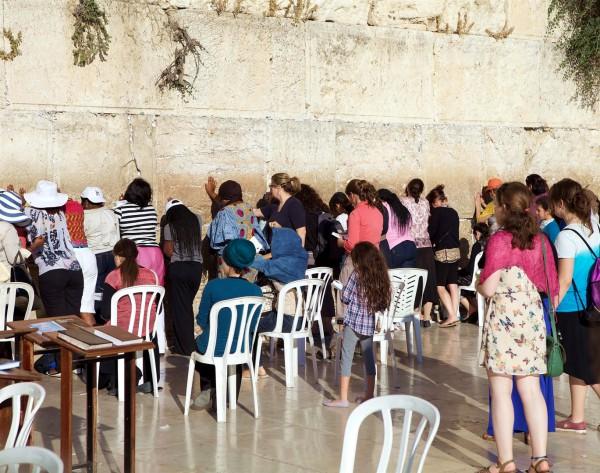 Women pray at the Kotel (Western Wall) in Jerusalem.