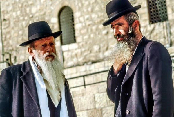 Two ultra-Orthodox Jewish men have a conversation in Jerusalem.
