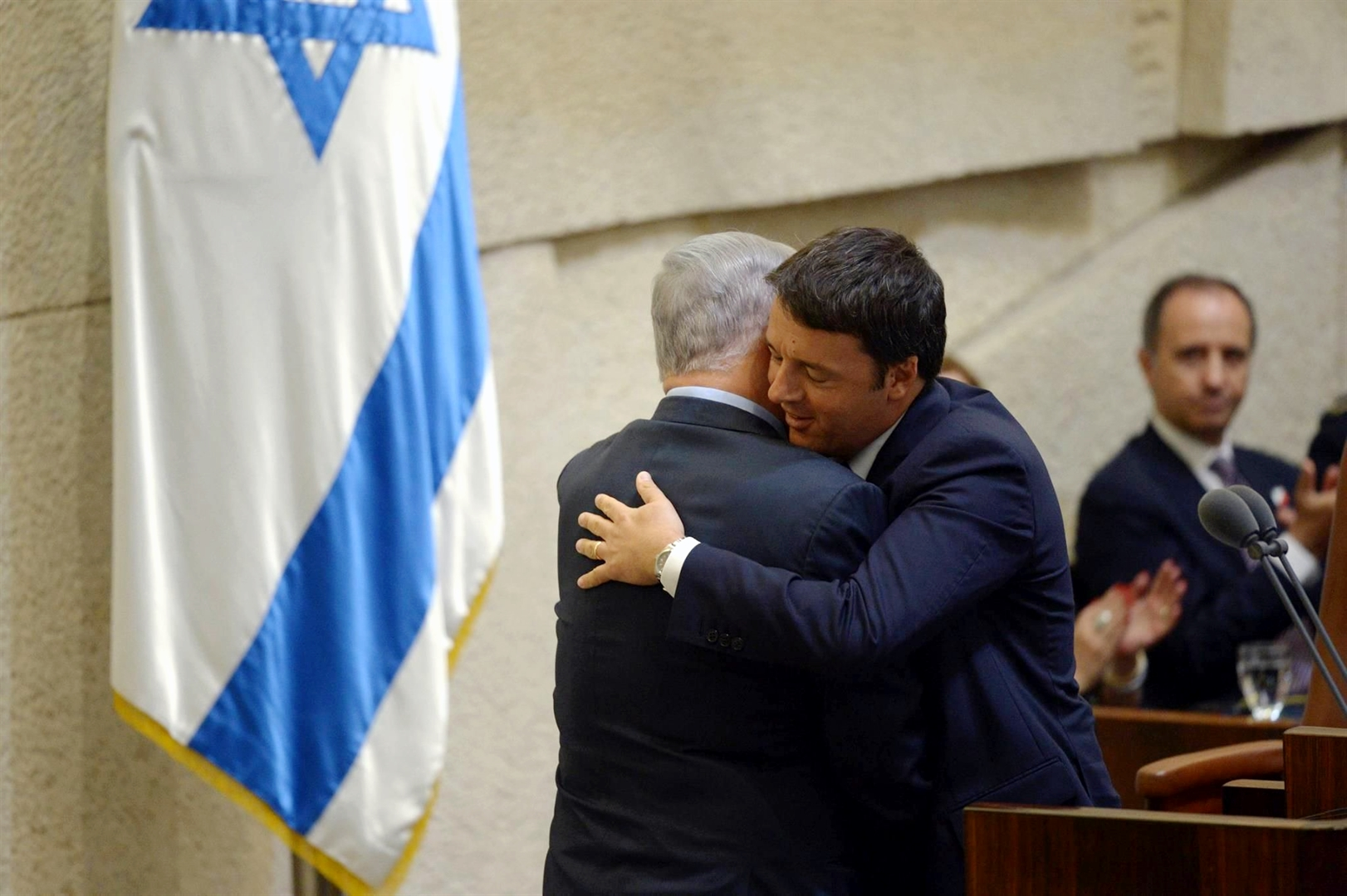 Prime Minister Benjamin Netanyahu and Italian Prime Minister hug warmly at a special Knesset session in honor of the Italian prime minister. (GPO photo by Amos Ben Gershom)