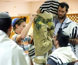 If the Torah scroll is not housed in a Torah tik (case), after the Torah reading, the Golel (roller) performs Gelila (rolling up). The Torah is then bound with a sash and covered with the Torah cover. The honor of being the Golel is sometimes given to a child under Bar Mitzvah age.