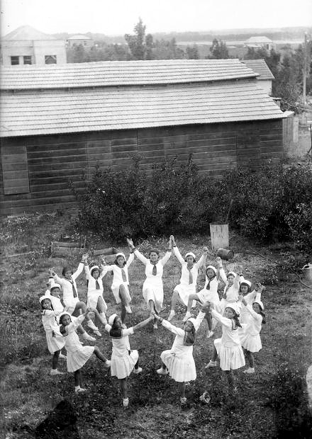 Girls wearing white dance on Tu B'Av in the Holy Land.