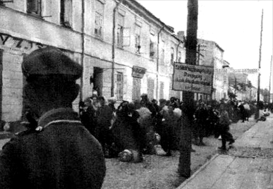 Jewish people are rounded up during the Holocaust for transport to death camps.