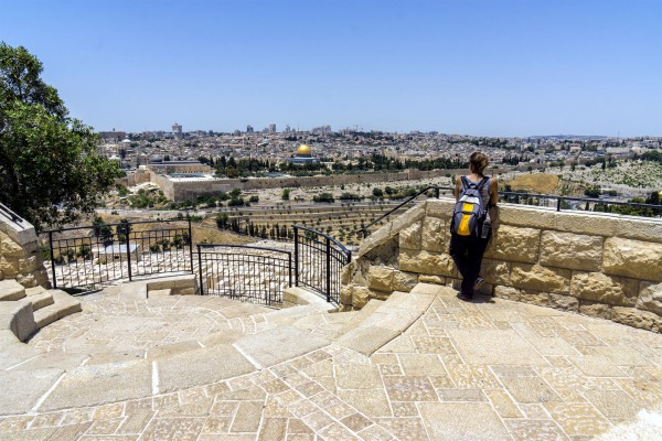 A woman looks toward the Temple Mount from the Mount of Olives.