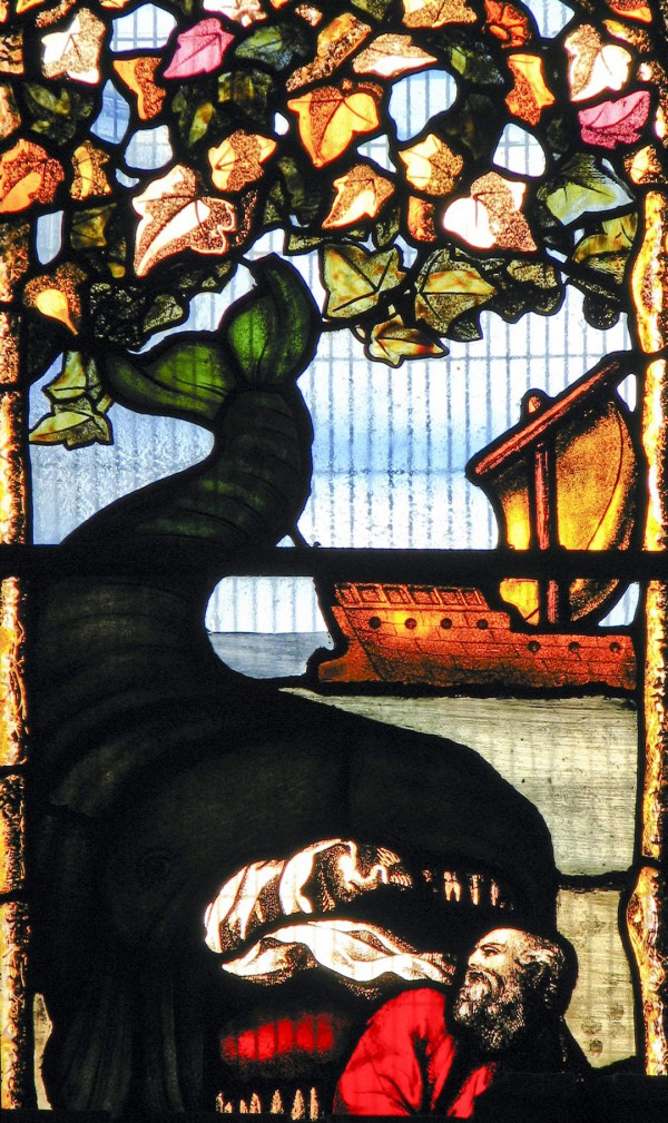 Jonah and the whale as depicted on a stained glass window in Oxford's Jesus College (photo by Fr. Lawrence Lew)