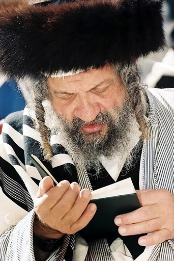 A Jewish man recites prayers.