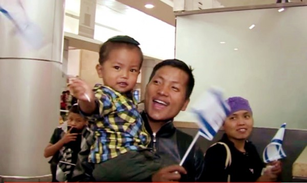 A Bnei Manashe couple immigrates to Israel with their child.  (YouTube capture)