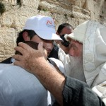 An observant Jewish Israeli blesses a father and son at the Western Wall (Israel Tourism photo by Sasson Tiram)
