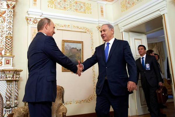 Israeli Prime Minister Benjamin Netanyahu (left) shakes hands with Russian President Vladimir Putin  at the Novo-Ogaryovo state residence outside Moscow, Russia, September 21.