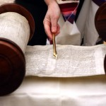 Torah scroll and yad (Torah pointer, literally, hand)