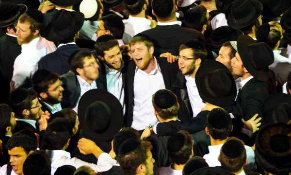Chassidic men dance together in an expression of their joyful relationship with God and one another.