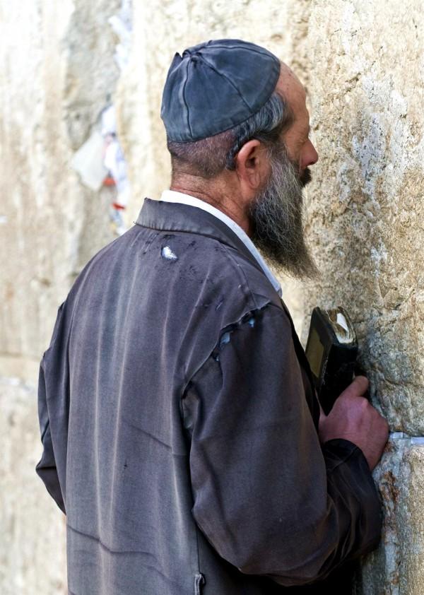 An impoverished Jewish man prays at the Western (Wailing) Wall.