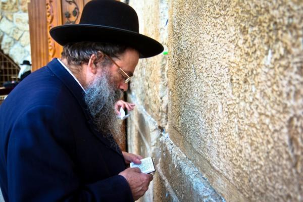 An ultra-Orthodox Jewish man prays at the Western (Wailing) Wall.