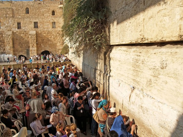 Women pray at the Women's Section of the Western (Wailing) Wall.