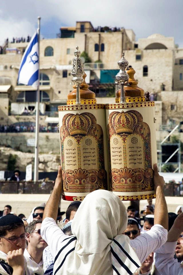The Torah scroll is raised for all to see at the Western (Wailing) Wall in Jerusalem.  (Photo by Uzi Yachin)