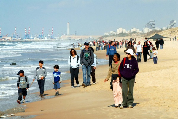 Israeli families walk together in a nature reserve near Ashdod.