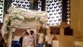 A Jewish man and woman exchange wedding vows under the chuppah. (Photo by Brett Lidder)