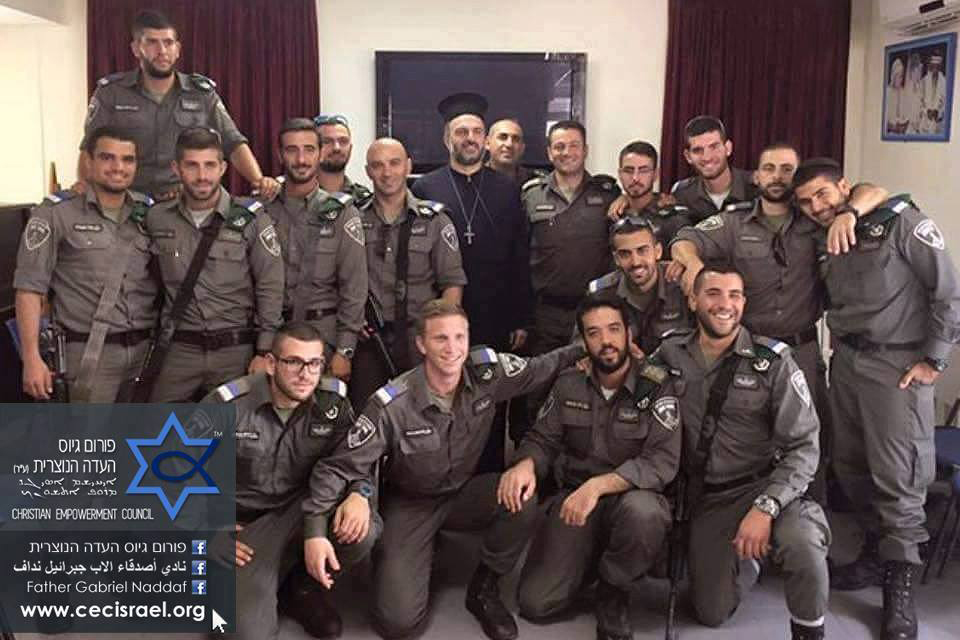 Father Gabriel Naddaf stands with Israeli Boarder Police <em> (Source: Gabriel Naddaf Facebook)</em>