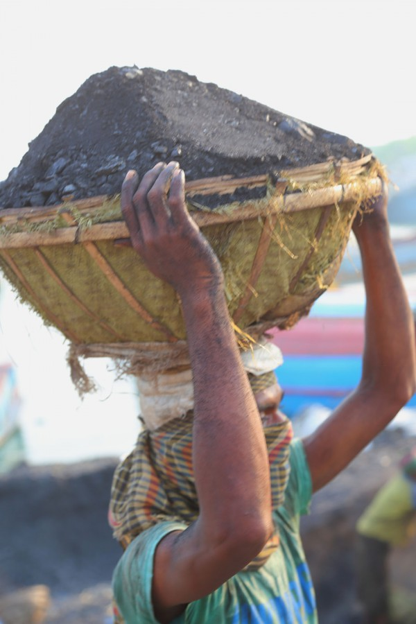 Man carrying coal on his head.