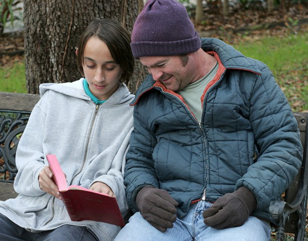 Teen shares the Word of God with a homeless man