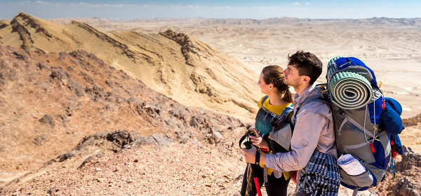 A couple stands at the Ramon Crater in southern Israel's Negev desert.