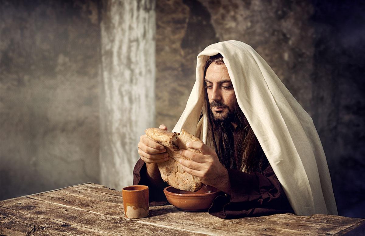 Jesus is breaking bread
