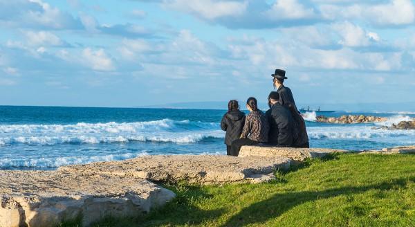 Jewish family overlooking Mediterranean Sea in Israel.