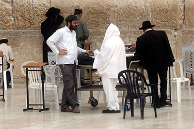 Men conversing at the Western (Wailing) Wall in Jerusalem.